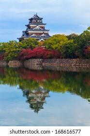Hiroshima castle on the side of Otagawa river in autumn