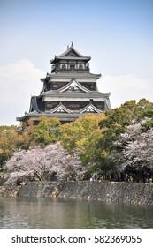 Hiroshima castle on the side of Otagawa river in spring, Hiroshima Prefecture, Japan