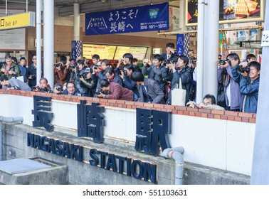 HIROSHIMA - JAN,8 : The journalists and people waiting  for welcome The ancient train was renovated for transportation from Hakata to Hiroshima Where is the world heritage . JAPAN JAN,8 2017
