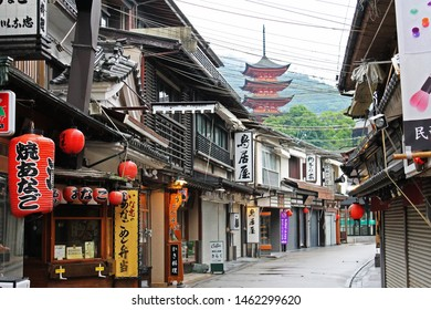 Hiroshima, Japan, - 07.05.2018: The pagoda of the Itsukushima Temple rises above the deserted and shuttered streets of the Miyajima Island village in the Hiroshima prefecture.