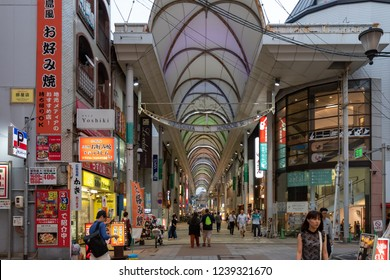 HIROSHIMA, JAPAN - JUNE 27, 2017: People shop in a covered city street in Hiroshima, Japan. Hiroshima is the largest city of Chugoku region with 1.17m population.