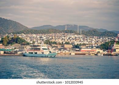 Hiroshima, Japan - NOVEMBER 21, 2017: Matsudai Kisen ferry crossing the inland sea between Miyajimaguchi and Miyajima island. (Vintage color tone)