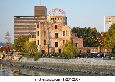 HIROSHIMA, JAPAN – NOVEMBER 23, 2007: Sunset view of the Atomic Bomb Dome, the skeletal ruins of the former Hiroshima Prefectural Industrial Promotion Hall on the rivershore of Ota river. Hiroshima