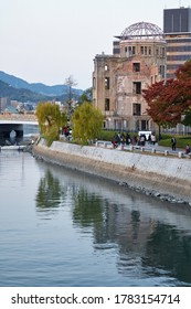 HIROSHIMA, JAPAN – NOVEMBER 23, 2007: The view of the Atomic Bomb Dome, the skeletal ruins of the former Hiroshima Prefectural Industrial Promotion Hall on the rivershore of Ota river.
