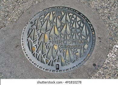 Hiroshima Prefecture, Chugoku region, Japan - September 21, 2009 - Manhole cover in Hiroshima decorated with Thousand Origami Paper Cranes (??? Senbazuru) that to pray for peace and Sadako Sasaki