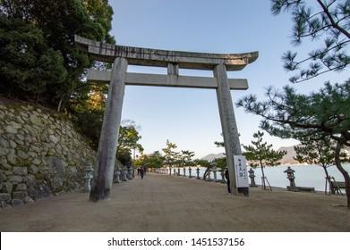 Hiroshima Prefecture /Japan - December 21, 2017: Entrance torii gateto the beautiful Itsukushima Shrine, a Shinto shrine on the island of Itsukushima (Miyajima) listed as a UNESCO World Heritage Site
