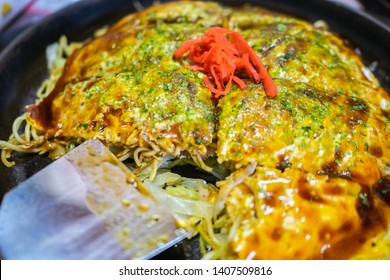 Hiroshima-style okonomiyaki in Hiroshima prefecture, Japan. Okonomiyaki is a Japanese-style pancake made from egg, flour and water with lots of toppings.
