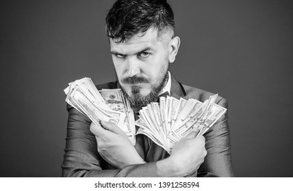 His cash holdings. Bearded man holding cash money. Currency broker with bundle of money. Rich businessman with us dollars banknotes. Making money with his own business. Business startup loan.
