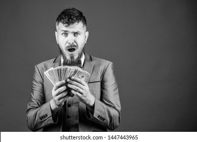 His first salary. Currency broker with bundle of money. Bearded man holding cash money. Rich businessman with us dollars banknotes. Making money with his business. Business startup loan, copy space.