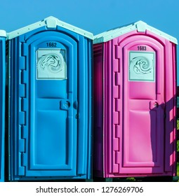 His and hers Colorful public outhouses blue and pink Urban exploration photography