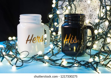 His and Hers personalised tea cups on white background, mugs, Christmas gift ideas, gifts wrapped with Christmas tree lights