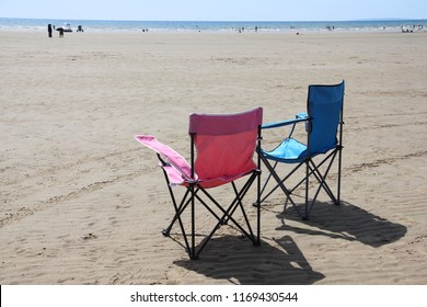 His and hers-sunchairs on beach at Blackrock sands Porthmadog