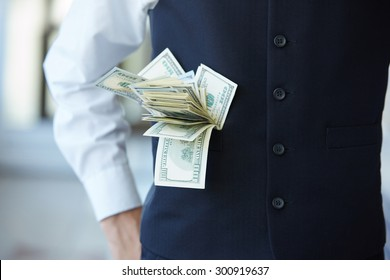 from his pocket a businessman sticking out of money