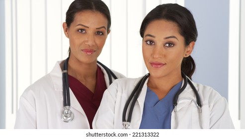 Hispanic and African American female doctors in hospital