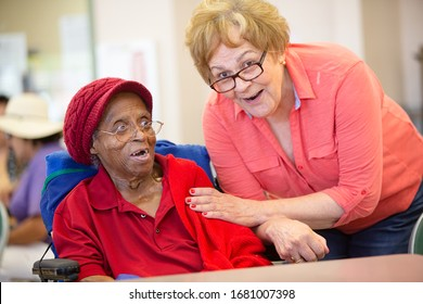 Hispanic and  African American women in a senior center