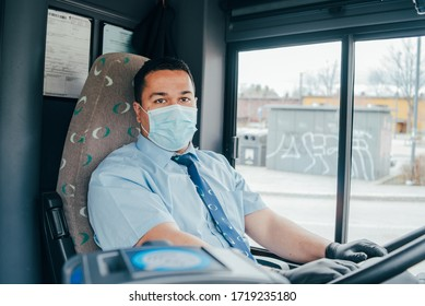 hispanic bus driver with mask in the protecting gloves on his hand in bus to protect himself from the coronavirus epidemic. Pandemic coronavirus 2020. Quarantine.Virus concept. Epidemic infection.
