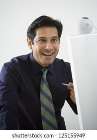 Hispanic business man smiling while using web cam