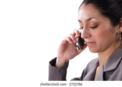 A Hispanic business woman using a cell phone. Right justified. Room for text. Isolated on white.
