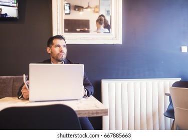 Hispanic businessman in coffee bar