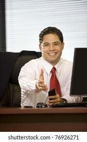 Hispanic Businessman Extending Hand for Handshake