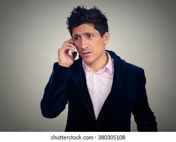 Hispanic businessman talking on phone