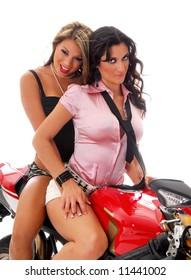 Hispanic and Caucasian glamor models on motorcycle isolated on white background