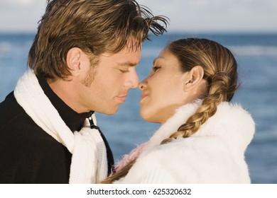 Hispanic couple about to kiss