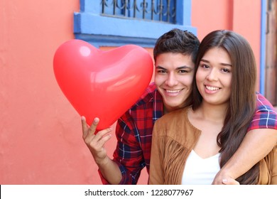 Hispanic couple celebrating Saint Valentines day