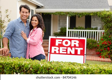 Hispanic couple outside home for rent