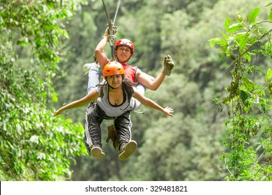 Hispanic Couple Tandem Zip Line