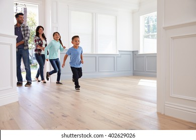 Hispanic Family Viewing Potential New Home