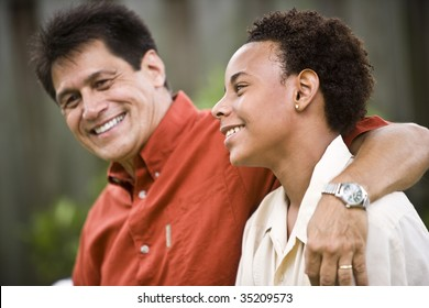 Hispanic father with African American teenage son