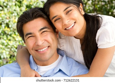 Hispanic father and daughter.
