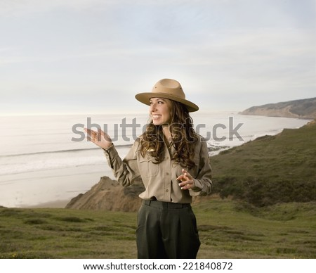 Hispanic female park ranger in front of ocean
