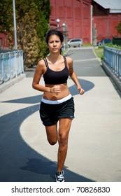 hispanic female running otuside on a sunny day