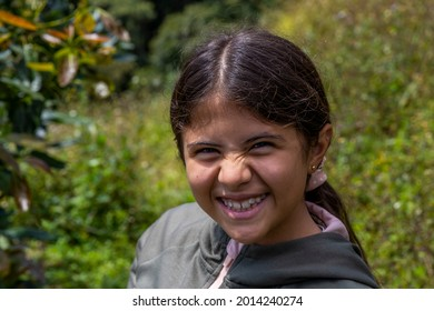 hispanic girl smiling in the country side