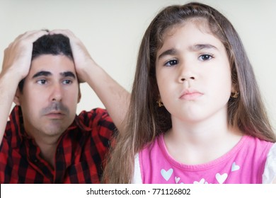 AN HISPANIC MAN ANGRY WHITH HIS DISOBIDIENT DAUGHTER