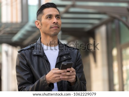 Hispanic man in city