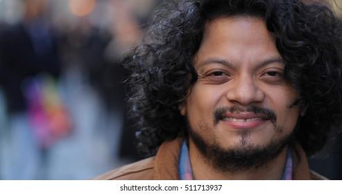 Hispanic man in city face portrait smile happy face