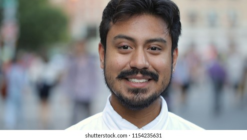 Hispanic man in city smile face portrait