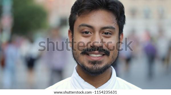 Hispanic man in city smile face portrait