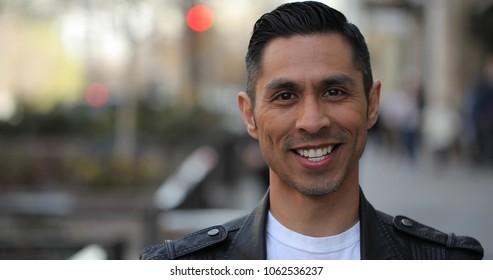 Hispanic man in city smile happy face