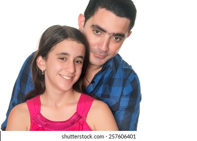 Hispanic man hugging her teenage daughter isolated on white