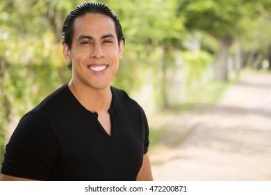 Hispanic man smiling.