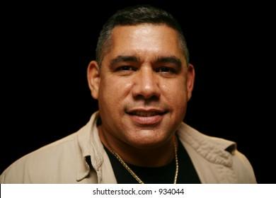 Hispanic man smiling at camera