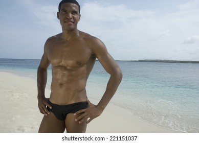 Hispanic man wearing bathing suit