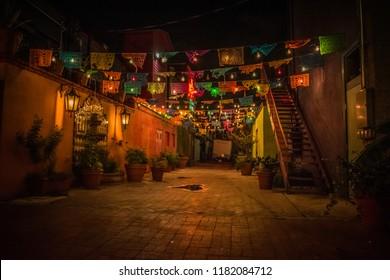 Hispanic market at night with flags and lights  Market Square San Antonio