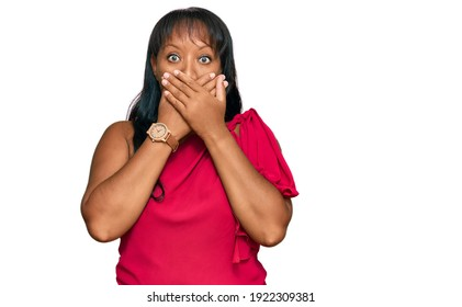 Hispanic middle age woman wearing casual clothes shocked covering mouth with hands for mistake. secret concept.