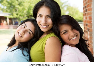 Hispanic mother and her daughters