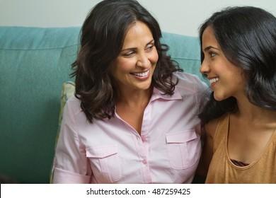 Hispanic mother talking to her teenage daughter.